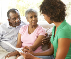 caregiver giving assessment to a elderly couple